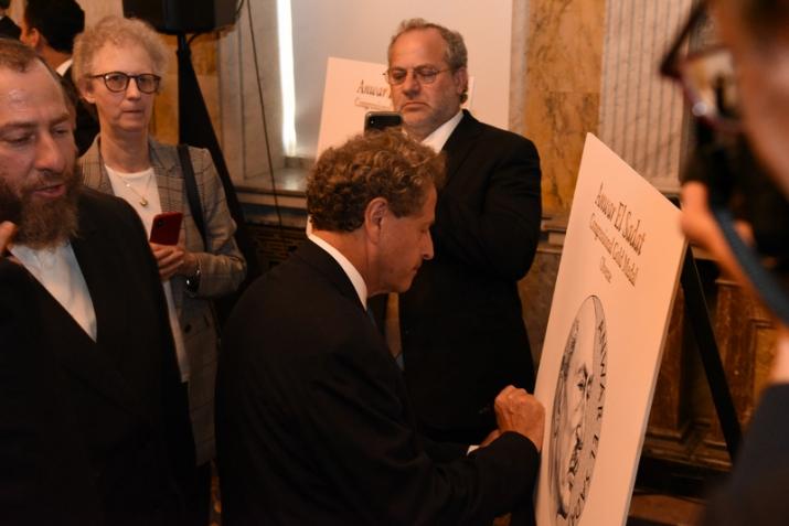 Assistant Secretary of the Treasury David Eisner signing the unveiled Gold Medal design, , , ezra friedlander