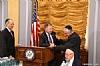 Michael Kierszenbaum, US Representative Doug Lamborn shaking hands Dr. Eli Schussheim, Woli Stern