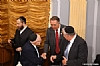 Ezra Friedlander, Woli Stern shaking hands with US Representative Trent Franks, Dr. Eli Schussheim,