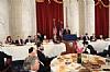 Ruth Lichtenstein, Stanley Treitel, Ambassador Norm Eisen, U.S. Senator Tim Kaine, Ezra Friedlander, J. Morton Davis, U.S. Senator Al Franken, U.S. Senator Jeff Merkley (speaking), Greg Rosenbaum, NYS Assemblymember Phil Goldfeder, Thomas B. Corby, Rabbi Hillel Zaltzberg