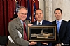 U.S. Senator Tim Kaine presenting award to Rabbi March Schneier, NYS Assemblymember Phil Godlfeder