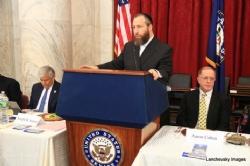Greg Rosenbaum, Ezra Friedlander delivering opening remarks, Aaron Cohen, EzraFriedlander