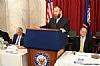 Greg Rosenbaum, Ezra Friedlander delivering opening remarks, Aaron Cohen