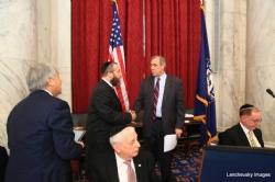 Greg Rosenbaum, Ezra Friedlander, US Senator Jeff Merkley (D-OR), Sitting: Joseph B. Stamm, Aaron Cohen, EzraFriedlander