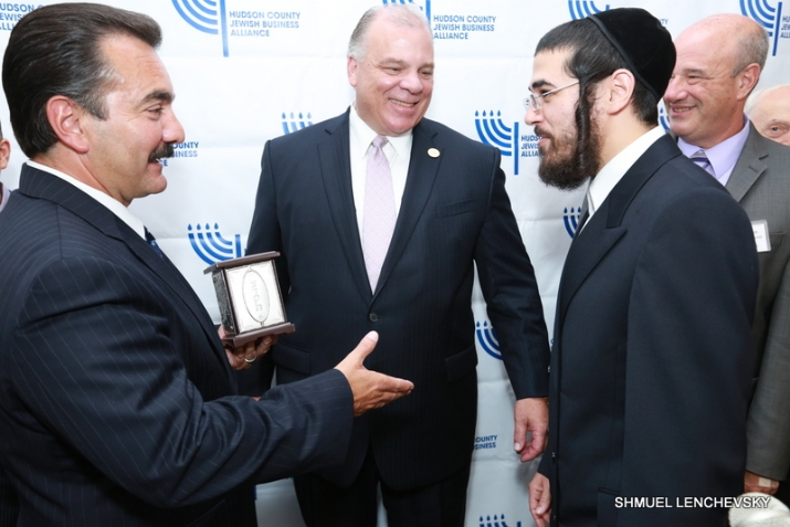 NJ Assembly Speaker accepting the award from David Rosenberg, NJ Senate President Sweeney looking on (middle), , , ezra friedlander