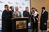 Yaakov Rosenberg, Moshe Schwartz, Eli Rowe, Superintendent of Port Authority Police Michael Fedorko, Moshe Stein with his young son presenting award to Superintendent, David Rosenberg