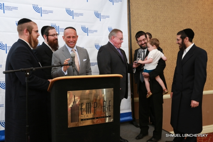 Yaakov Rosenberg, Moshe Schwartz, Eli Rowe, Superintendent of Port Authority Police Michael Fedorko, Moshe Stein with his young son presenting award to Superintendent, David Rosenberg, , , ezra friedlander