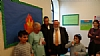 (L to R) Chancellor Carmen Fariña, Ezra Friedlander, CEO of The Friedlander Group, Dr. Joshua Weinstein, CEO and Founder of Shema Kolainu - Hear Our Voices surrounded by happy students during Chancellor's visit and tour