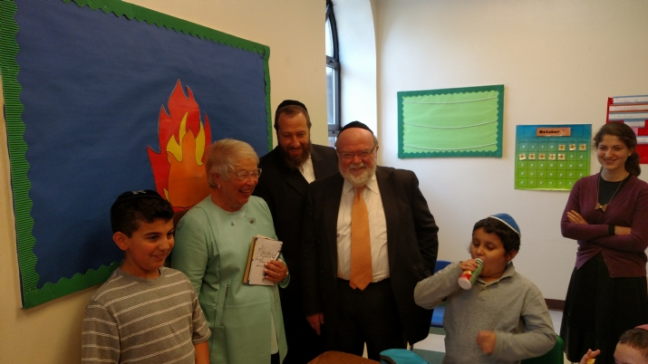 (L to R) Chancellor Carmen Fariña, Ezra Friedlander, CEO of The Friedlander Group, Dr. Joshua Weinstein, CEO and Founder of Shema Kolainu - Hear Our Voices surrounded by happy students during Chancellor's visit and tour, , , ezra friedlander