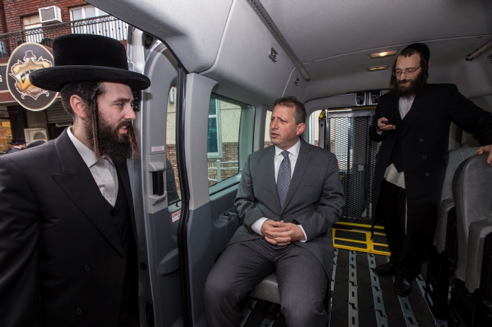 NYC Councilmember Brad Lander with Hamaspik's Naftuli Tessler in one of the new vans, , JerryNadler, ezra friedlander