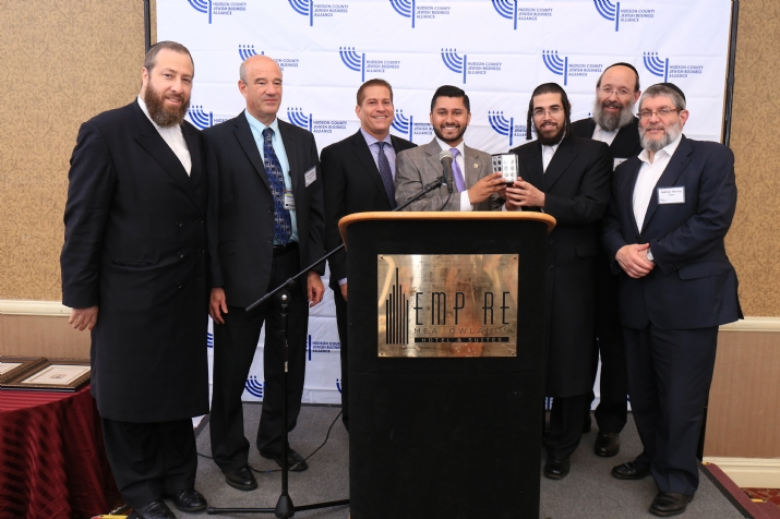 L-R: Ezra Friedlander, CEO, The Friedlander Group; Mark Rabson, Director of Public Affairs, Jersey City Medical Center; Jason Sobel, Of Council RE, Sills Cummis & Gross; Honoree Assemblyman Raj Mukherji; David Rosenberg, Executive Director, HCJBA; Aron Stahl, VP, Gel Spice; Nathan Herzog, EVP, Royal Wine., , , ezra friedlander