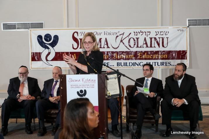 Dr. Joshua Weinstein, Menachem Lubinsky, Queens Borough President Melinda Katz (Speaking), NYC Councilmember Kalman Yeger, Ezra Friedlander, , , ezra friedlander