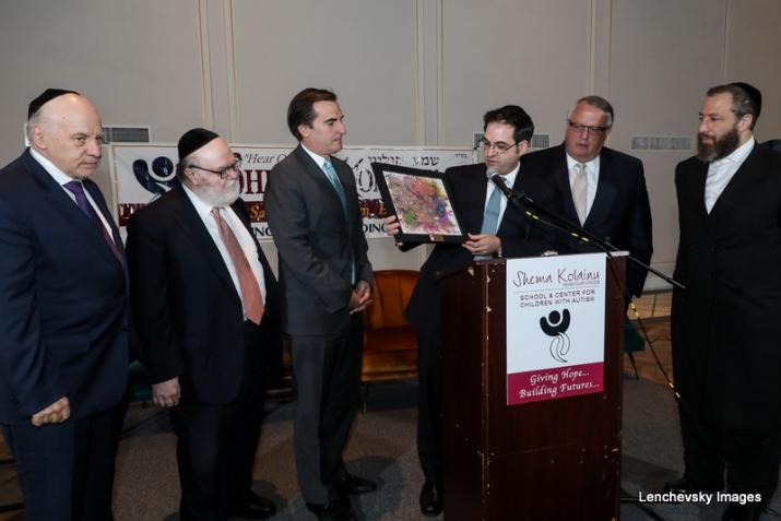 Menachem Lubinsky, Dr. Joshua Weinstein, NYS Senator Michael Gianaris (receiving award), NYC Councilmember Kalman Yeger, Peter Rebenwurzel, Ezra Friedlander, , , ezra friedlander